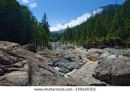 Clear mountain river near Port Alberni, Vancouver Island - stock photo