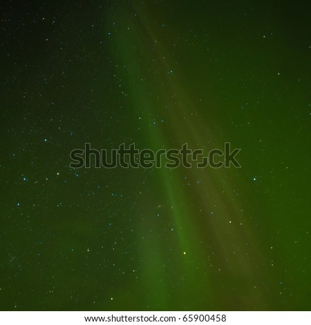 Clear night sky with lots of stars and faint northern lights (Aurora borealis) display. - stock photo