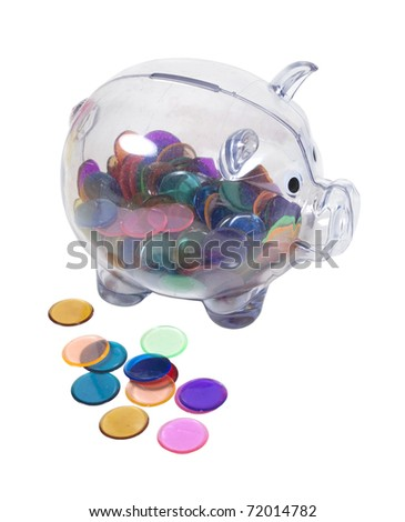 Clear piggy bank full of colorful chips instead of money - path included - stock photo