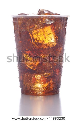 Clear Plastic Cup of Cola with Ice isolated on white with reflection vertical format low angle - stock photo