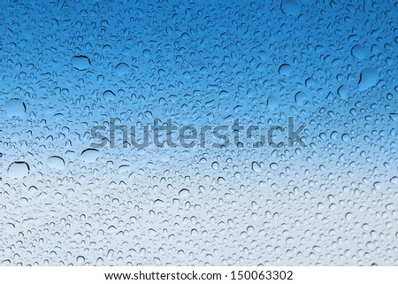 Clear raindrops on windscreen with blue and white  background  ideal for  unique abstract wallpapers. - stock photo