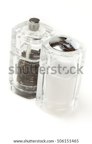 Clear Salt and Pepper Shakers on a background