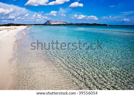 Clear sea and sandy beach La Cinta, Sardinia, Italy - stock photo