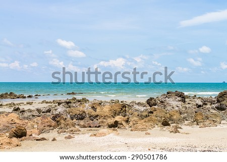 clear sky and sea view with rocks from the beach in thailand - stock photo
