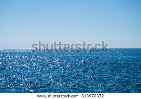 Clear sky over the blue sea - stock photo