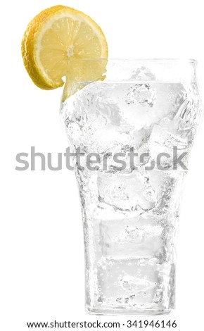 clear soda in a glass container with a slice of lemon - stock photo