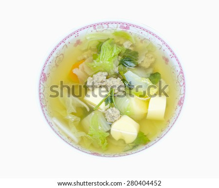 clear soup with bean curd and minced pork in dish on white background - stock photo