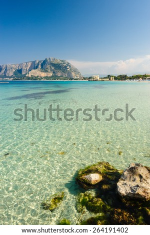Clear turquoise waters of Mondello beach, Palermo, Sicily, Italy. - stock photo