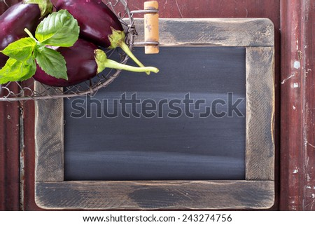 Clear vintage chalkboard with eggplants on the side - stock photo