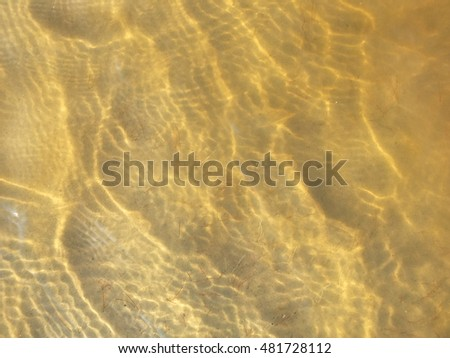 clear water above sand bottom on wind