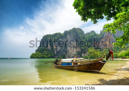 Clear water and blue sky. Beach in Krabi province, Thailand. - stock photo