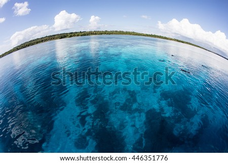 Clear water covers a diverse reef in Wakatobi National Park off the southern coast of Sulawesi, Indonesia. This area is part of the Coral Triangle and harbors extraordinary marine biodiversity.