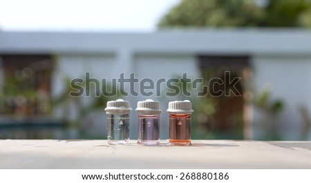 Clear water in water testing glass bottle - stock photo