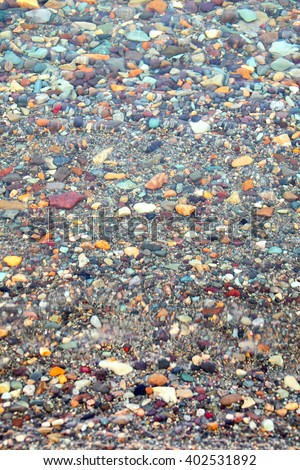 Clear water with pebble bottom - stock photo