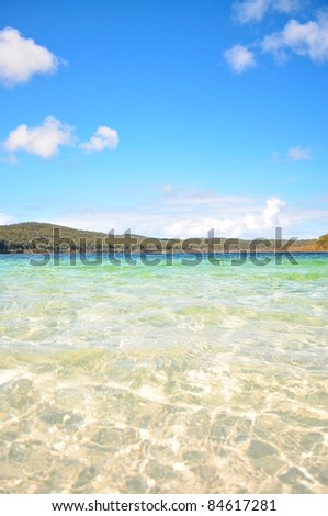 Clear Waters of Lake McKenzie, located on Fraser Island, Queensland Australia.  It is a fresh water lake famous for its clarity and purity. - stock photo