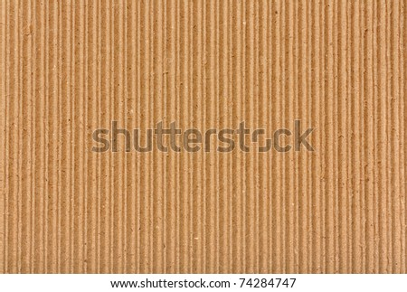 Clear yellow corrugated cardboard texture. Closeup. Horizontal - stock photo