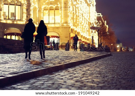 Clearance night shopping in the city - stock photo
