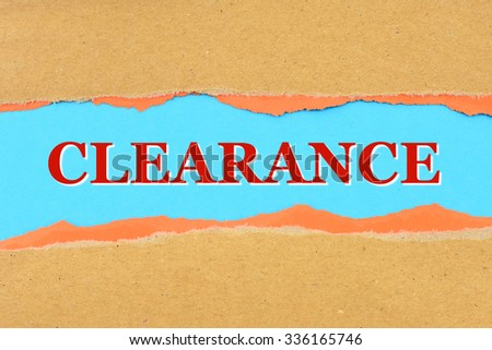 CLEARANCE on a torn paper - stock photo