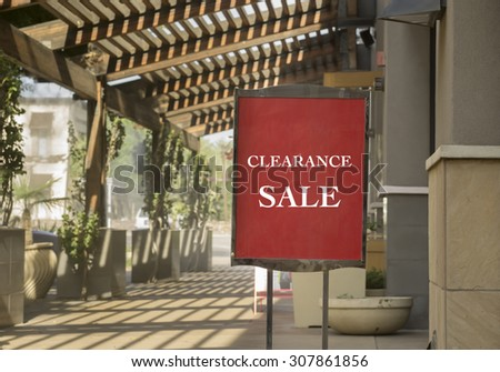 Clearance sale sign outside shop in outdoor upscale shopping mall - stock photo