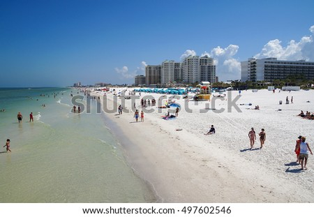 CLEARWATER BEACH, FLORIDA, USA - 18 May 2013: Tourists on the beach enjoying the sun. Clearwater Beach is a popular vacation destination on the Gulf coast of Florida in the United States