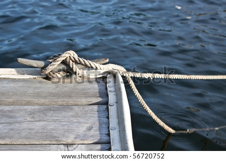 cleated rope on dock - stock photo