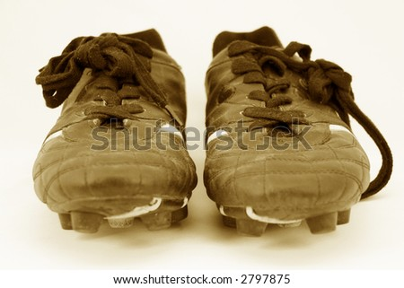cleats head on in sepia - stock photo