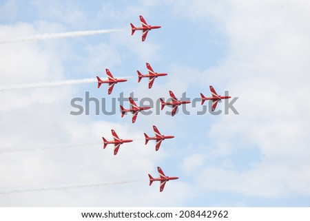 CLEETHORPES, ENGLAND JULY 27TH: Royal Air Force Red arrows perform an aerobatic display at Cleethropes airshow on 27th July 2014 in Cleethorpes England. - stock photo