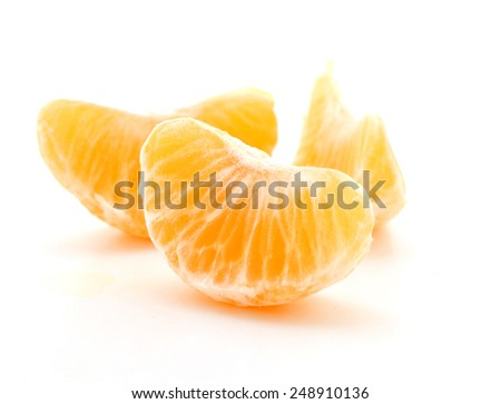 Clementine orange wedges isolated over a white background. - stock photo