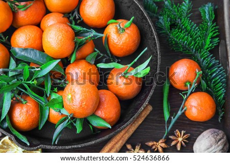 Clementines fruits with winter spices and fir tree branches
