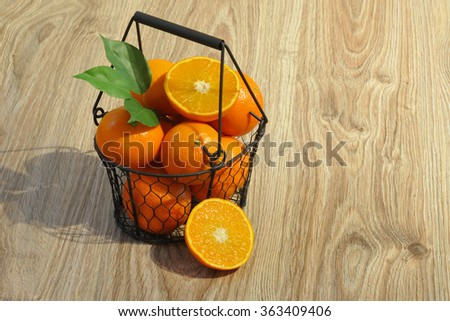 Clementines in a basket. - stock photo