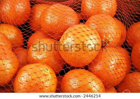 Clementines in a netted bag and box - stock photo