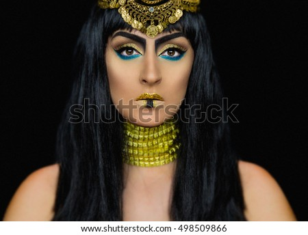 Cleopatra halloween makeup with a caucasian girl posing in the studio