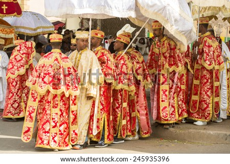 Clergy of the Ethiopian Orthodox church dressed in beautiful traditional clothing during a colorful procession of the Timket (Epiphany) celebrations, on January 19, 2015 in Addis Ababa. - stock photo
