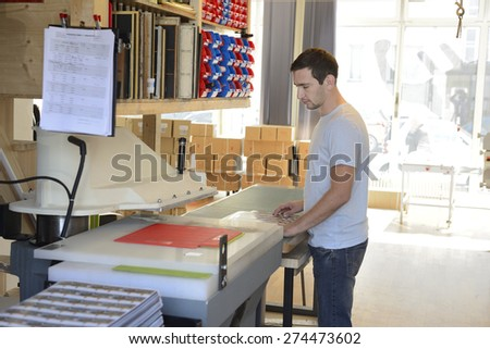 Clerk checking the print result. - stock photo