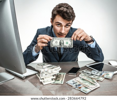 Clerk showing his earnings, profit, income, earnings, gain, benefit, margin / modern office man at working place, depression and crisis concept - stock photo
