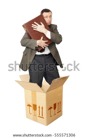Clerk with a suitcase appears out from the cardboard box. Isolated over white