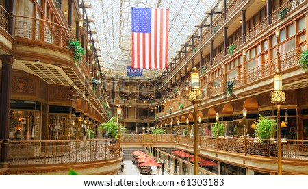 CLEVELAND - JULY 24: Early morning visitors begin to gather in Cleveland's Old Arcade, one of the city's most venerable and historic attractions in Cleveland Ohio, July 24, 2010 - stock photo