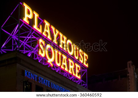 CLEVELAND, OH - JANUARY 1, 2016: Cleveland's theater district, Playhouse Square, is announced by a massive rooftop lighted sign on Euclid Avenue, above a Kent State University branch campus. - stock photo