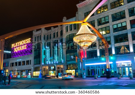 CLEVELAND, OH - JANUARY 1, 2016: One of Cleveland's splashiest new landmarks is the giant chandelier suspended above Euclid Avenue in the center of the theater district, Playhouse Square. - stock photo