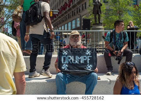 CLEVELAND, OH - JULY 20, 2016: An anti-Trump protester holds a sign with Nazi connotations on Public Square during the Republican National Convention.