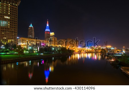 CLEVELAND, OH - MAY 28, 2016: View of Cleveland's riverfront with colorful Terminal Tower and Quicken Loans Arena (the Q), the site of the NBA Finals and of the Republican National Convention in July. - stock photo