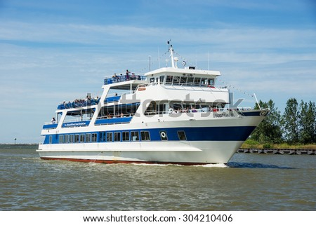 CLEVELAND, OHIO   AUGUST 7, 2015: The tourist excursion vessel Goodtime III has been cruising the waters of the Cuyahoga River and Lake Erie at Cleveland, Ohio since 1990. - stock photo