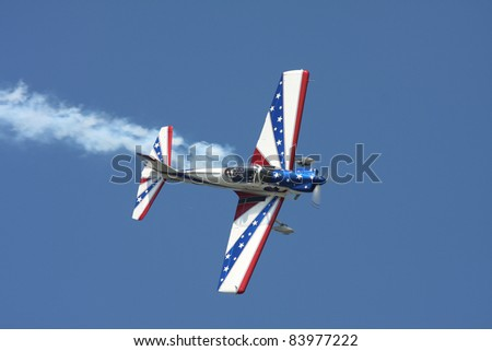 CLEVELAND, OHIO - SEPT. 3: Red, White and Blue stunt plane performs at the Cleveland National Airshow on Sept. 3, 2011 in Cleveland, Ohio. - stock photo