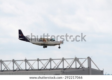 CLEVELAND, USA - JUNE 30, 2015: FedEx Cessna 208B at Cleveland Hopkins International Airport .