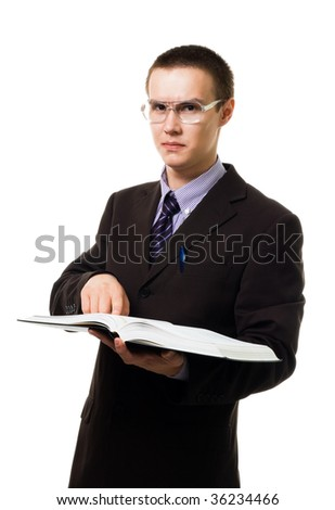 Clever man with huge book in glasses look at camera isolated on white