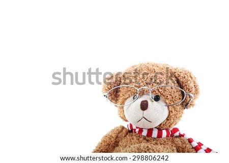 Clever teddy bear on a white background with glasses - stock photo