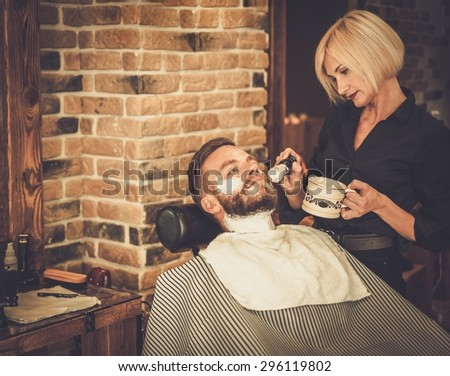 client during beard moustache grooming barber stock photo 296119817 shutterstock. Black Bedroom Furniture Sets. Home Design Ideas