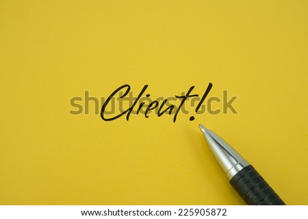 Client! note with pen on yellow background - stock photo