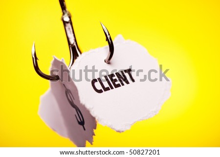 Client on peace of paper pierced in hook - stock photo