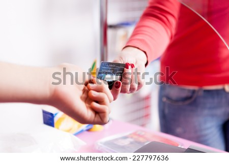 Client Paying with credit card in pharmacy. Business style. Modern payment - stock photo